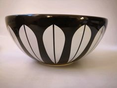 """The Arne Clausen collection with the iconic """"Lotus"""" pattern originally designed by the Norwegian artist Arne Clausen in the has been reissued in ceramic earthenware. Contrasting white on black. No markings. Measures diameter and high. Earthenware, Lotus, 1960s, Ceramics, Retro, Tableware, Artist, Pattern, Stuff To Buy"""