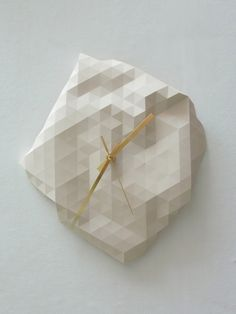Faceted Wall Clock. via Etsy.
