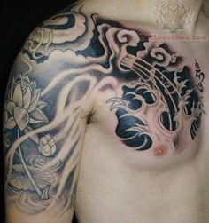 Lotus Black Ink Tattoo On Sleeve And Chest