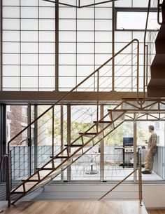 Architects Laura Briggs and Jonathan Knowles revamped a dilapidated turn-of-the-century townhouse in Harlem by replacing the brick rear elevation with a curtain wall of sliding glass doors, translucent panels, and glass windowpanes.