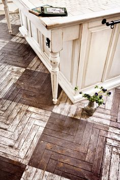 Loving this rustic wood floor! Chevron and diamond pastern in one!