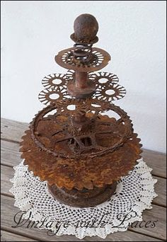 Rusty Junk Christmas Tree - made from salvaged gears, springs, bolts, etc.  How clever!!!