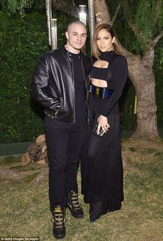 Cute couple: Posing up a storm with Casper Smart, she looked every inch the leading lady in her sexy cut-out ensemble