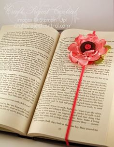 Bookmark.  Wouldn't want to put it inside of a book, but I'm looking for a few books to alter, as well as to turn into keepsake boxes, & these would look very pretty on the outsides of the books/boxes.