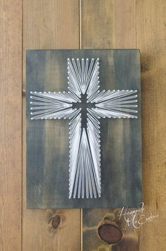 Thank you for checking out my shop! This unique, cross string art piece makes a great addition to any home, studio OR a great gift for someone! It can stand on any shelf, be displayed on a stand, or a wall hanger can easily be attached to the back for added decor to your walls. Comes with a wire wall hanger attached to the back for easy wall display. Handmade  Hand strung by me, with special attention given to detail. Dimensions: 8x10in. 3/4in. thick  Wood color: Ebony wood stain on pine...