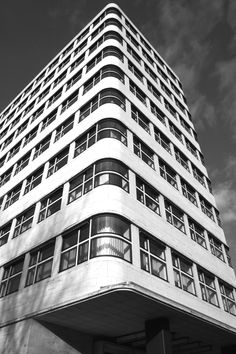black and white photography of a berlin building