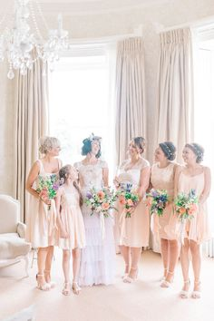Bride Laura wore a tiered wedding dress by Katya Katya Shehurina for her peach…