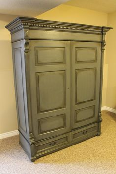 "After - Armoire.  Annie Sloan Chalk paint; Graphite and French Linen, 50/50 mix.  Graphite trim details.  Graphite ""wash"" over details,carvings then dry ragged off.  Then heavily dark waxed.  Handles done in rubbed oil bronze.  #ASCP #morethanpaint Check my other projects!"