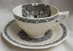 Antique  Black English Transferware Cup and Saucer  Embossed Floral Border Rural England.