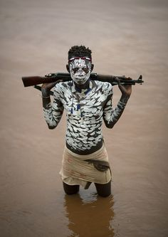 Karo tribe teen in Omo river - Ethiopia  Photo credit: Eric Lafforgue