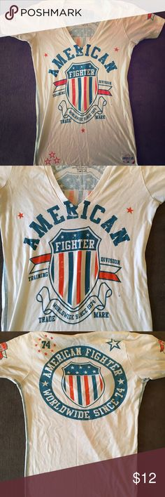 American Fighter shirt Gently used.  Size medium.  Blue orange colors.  V neck. Shirt fit small on me. american fighter Tops Tees - Short Sleeve