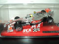 SCX F1 Vodafone McLaren Mercedes -SCX Vodafone McLaren Mercedes F1 Lewis Hamilton 2010. This McLaren Mercedes F1 1/32 scale model slot car by SCX will give you some great electric slot car track action. It is fitted with magnatraction, front wheel steering with free wheeling front wheels, self-centering easy change sprung guide, tilting engine cradle to allow body roll and displayed in a clear crystal case for your collection. SCX Tecnitoys made in Spain…