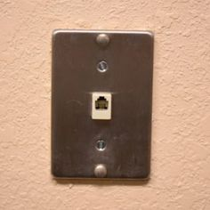 Cover up old wall-mounted phone jack with one of these ideas. The phone jack is becoming a thing of the past. Plain Wooden Boxes, Wall Jack, Empty Picture Frames, Diy Home Repair, Electrical Tape, Old Wall, Home Repairs, Home Improvement Projects, Just In Case