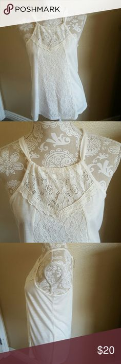 HP NWT Beautiful Cream Tank Top size M HP 9/19 NWT Beautiful Cream Tank Top size M Super soft and comfy cotton tank with lace detail down the front. Very cute neckline. I never wore as best suited I think for a small bust..sad to let it go but didn't fit how I would like Boutique Tops Tank Tops