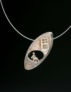 Holly R Dobkin - Woman on the edge pendant. Sterling silver, stainless steel cable, fabricated, cast.