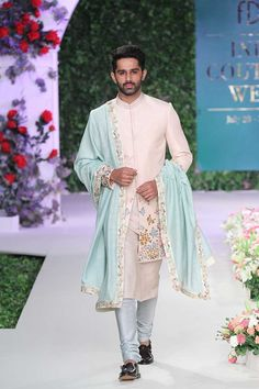 Love this baby pink teal blue sherwani set from the collection Vintage Garden by Varun Bahl Blue Sherwani, Sherwani Groom, Mens Sherwani, Wedding Sherwani, Vintage Wedding Suits, Wedding Dresses Men Indian, Wedding Dress Men, Wedding Groom, Vintage Bridal