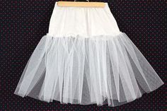 How to Make a Crinoline for a Poodle Skirt Making your own crinoline is easy—the materials are inexpensive and readily available at any fabric store. Since very little (if any) is meant to show, you don't have to be an expert seamstress either. Poodle Skirt Pattern, 1950s Poodle Skirt, Poodle Skirt Costume, Poodle Skirt Outfit, Poddle Skirt, Sock Hop Outfits, Girls Petticoat, Crinoline Skirt, Cotton Slip