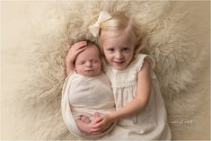 studio newborn boy sister sibling toddler  Ashleigh Whitt Photography - West Cleveland Newborn Baby Photographer