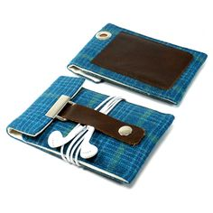 iPod / iPhone case with a pocket for credit card - turquoise and green wool. $40.00, via Etsy. Super  cute cases at her shop.