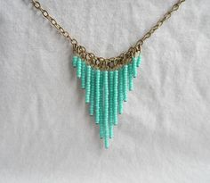 Puka Shell Necklace and Other Amazing Jewelry DIYs for Added Flair … Collier de perles turquoise Seed Bead Jewelry, Beaded Jewelry, Seed Beads, Beaded Necklaces, Marble Jewelry, Seed Bead Necklace, Bohemian Jewelry, Silver Necklaces, Beaded Earrings