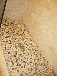 Oh, how I love a river rock shower floor - makes you feel like you're standing in the lake. :)