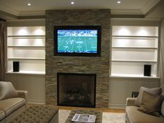 "stacked stone w/ wall mounted TV. Can be in the ""formal"" living room or as most places we've seen so far - the basement tv room!!!"