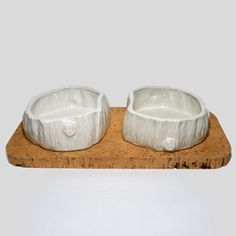 white big dog bowls on cork