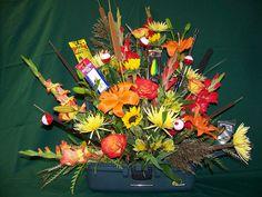Custom, sympathy floral arrangement in a tackle box.