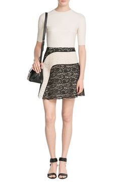 Stretch Knit Pullover CARVEN € 240    product	 Lace Mini Skirt CARVEN € 570    product	 Fiamma Leather Shoulder Bag SALVATORE FERRAGAMO € 1.290    product	 Leather Wedges PIERRE HARDY € 550