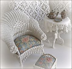 1:12th scale miniature wicker chair and footstool by Carolyn Lockwood ... tea set by Amanda Skinner. Monica Roberts collection