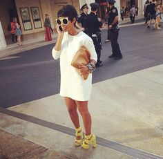 white sunglasses + white dress + brown clutch + yellow chunky heels
