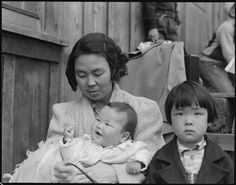 A Japanese family waiting to be evacuated - Dorothea Lange (May, 1942)