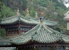 Figures on Temple roof at Summer Palace in Beijing  by econdoc