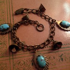 Vintage Copper Turquoise Stone Bell Charm Bracelet Copper with faux turquoise colored stones set in seashell like charms. Bells work and  are charmy sounding when moving! Clasp for closure and needs a light cleaning. Has been chilling out in my jewelry box for several years now :) Vintage Jewelry Bracelets