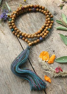 Mala made of 8 mm - 0,315 inch, beautiful wood color jasper and faceted agate gemstones. Together they count as 108 beads. The mala necklace is