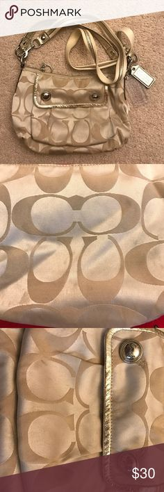 coach poppy gold purse Gently used poppy coach bag. Some normal wear small stains that can be easily cleaned. The pictures show the small stains. Used only a few times. Coach Bags Crossbody Bags