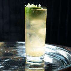 Half a lime 1.5 oz Bourbon Club soda