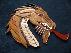 Intarsia dragon that I made. No paint, just colored wood. Intarsia Wood Patterns, Intarsia Woodworking, Woodworking Tools, Celtic Patterns, Scroll Saw Patterns, Photo On Wood, Wooden Art, Sculpture, Wooden Jewelry