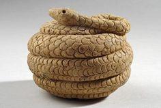 Near Eastern Terracotta Snake   Animals   Date:  1st Century BC Culture:  Syrian Category:  Animals Medium:  Terracotta