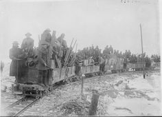 MINISTRY INFORMATION FIRST WORLD WAR OFFICIAL COLLECTION (Q 1699)   Working party of British troops going up to the forward area by light railway; Elverdinghe, near Ypres, February 1917.