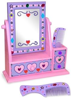 Beautiful and practical, this wooden vanity set is designed with a safety mirror, a handy storage compartment for two wooden combs and a convenient drawer for all your hair accessories. This kit also includes craft glue, sparkling gems, and stickers to add that individual touch!