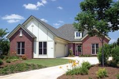 We have created an elegant design reflective of the Arts and Crafts era. Copper roofing and carriage style garage doors warmly welcome guests into this sp...