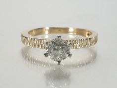 hadn't considered modern, but this shank appeals... reminds me of tree bark  Old European Cut Diamond Engagement Ring - Vintage Ring in New Condition - 0.47 Carat Solitaire - Appraisal Included