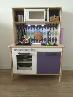 Ikea Duktig kitchen pimped with Limmaland stickers, added some knobs and a ledlight (battery charged)