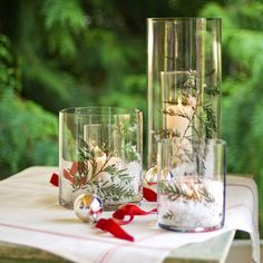 Your home welcomes family and guests. Dress it up for the holidays with the beauty of festive Christmas centerpieces adorned with all that glitters and glows. Create a statement on your holiday tab. Easy Christmas Crafts, Simple Christmas, Winter Christmas, Christmas Holidays, Christmas Candles, Christmas Scenery, Xmas, Christmas Stuff, Christmas Lights