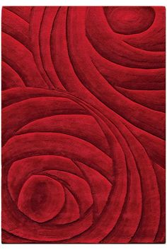 The Optics Area Rug also comes in several shapes and sizes and I'd use it to tie two rooms together with a similar-but-different effect.
