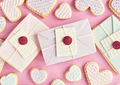 Delightful love letter cookies with a fondant wax seal made with a classic single initial shelley script font.  see more options at http://www.nostalgicimpressions.com/Single_Initial_Wax_Seal_Stamps_Stock_or_Custom_s/198.htm