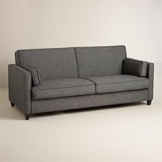 World Market - Charcoal Gray Nolee Folding Sofa Bed $699. Folds flat to a bed and also has storage underneath the cushions.