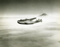Boeing 314 Clipper, with Mt. Rainier in the background, circa. 1938