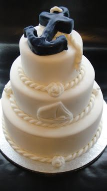 no anchor no sailboat just a simple white cake with nautical lines between each layer simple and perfect!